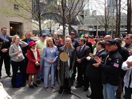 May 2, 2014, Announcement of the formation of a committee to establish a 9/11 Responders & Survivors' Monument to honor those sickened and dying from their actions during and after the 9/11 attacks. From left to right in front, Kimberly Flynn, Chair of the WTC Health Program's Survivors Steering Committee,  NYC Council Member Margaret Chin, U.S. Rep. Carolyn B. Maloney, Manhattan Borough President Gale Brewer,  NYC Uniformed Fire Officers President Al Hagan NYS AFL-CIO Executive Assistant to the President and 911 Health Watch Board member Suzy Ballantyne,  U.S. Rep Jerrold Nadler,   President of the FealGood Foundation John Feal.