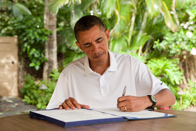"President Barack Obama signs H.R. 847, the ""James Zadroga 9/11 Health and Compensation Act"" in Kailua, Hawaii, Jan. 2, 2011. (Official White House Photo by Pete Souza)"